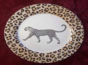 Cheeta on white porcelain plate